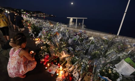 People light candles at a makeshift memorial on the Promenade des Anglais in Nice in tribute to the victims of the Bastille Day attack.