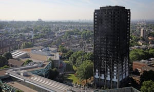 Grenfall Tower still smoulders after a devastating blaze that killed at least 12 people.