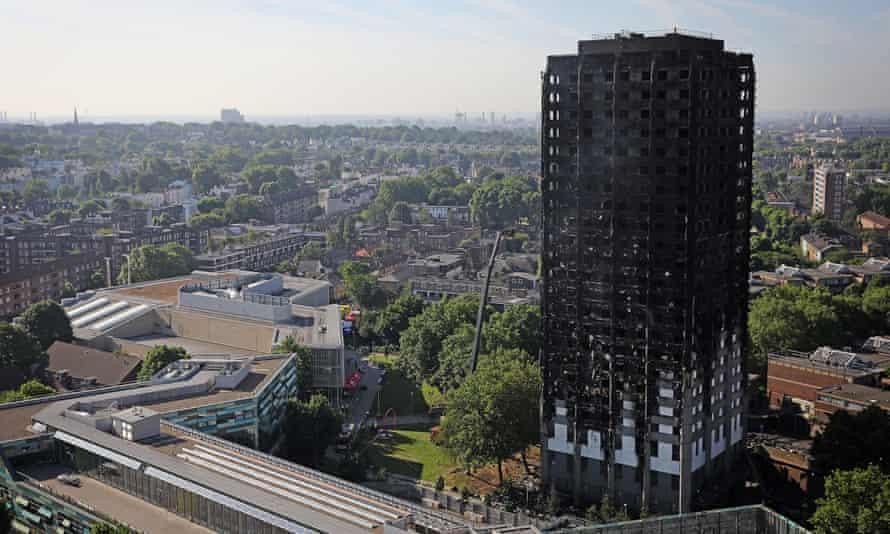 Grenfall Tower still smoulders after a devastating blaze that killed at least 12 people.