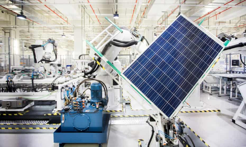 A robot handles a solar panel on the module production line in Singapore.