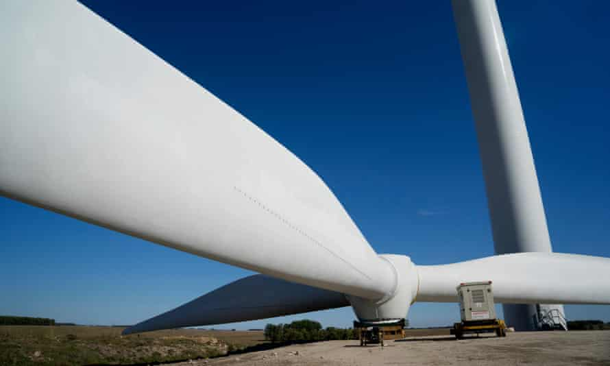 Wind turbine blades are assembled on the ground at a wind farm in Uruguay