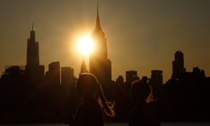The sun rises behind the Empire State Building and Chrysler Building in New York City this week
