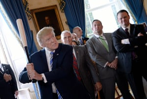 """President Donald Trump swings a Marucci baseball bat in the Blue Room during a """"Made in America"""" product showcase event at the White House in Washington, DC, on July 17, 2017"""