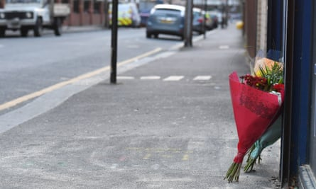 Flowers at the scene of a fatal stabbing