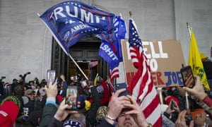 Trump supporters gather outside the Capitol in Washington on January 6, before the mobs invaded while both chambers of Congress were in session, working to certify Joe Biden's victory in the 2020 election.