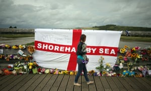 Floral tributes to the victims of the disaster near the A27 at Shoreham.