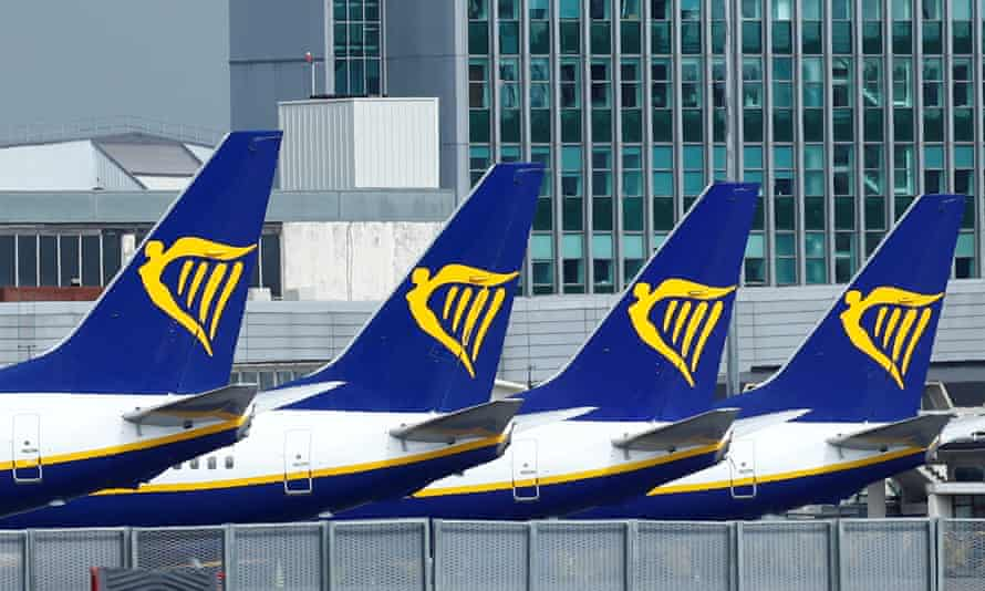 Ryanair jets parked on the runway of Dublin airport.