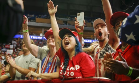 Attendees cheer while Donald Trump speaks during his campaign rally at The BOK Center in Tulsa, Oklahoma.