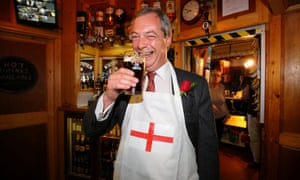 Nigel Farage holds a pint of beer
