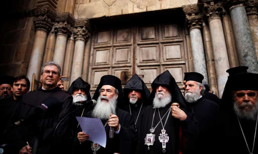 The Greek Orthodox patriarch of Jerusalem, Theophilos III, speaks in front of the closed doors of the Church of the Holy Sepulchre in Jerusalem's Old City.