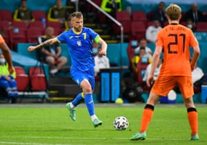 Ukraine's Andriy Yarmolenko scores their first goal.
