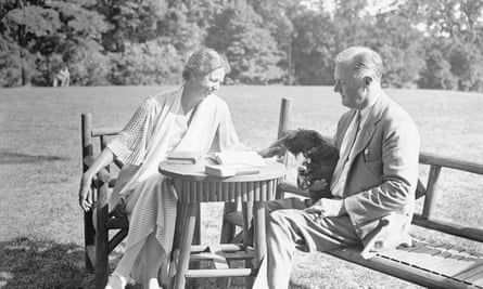 Eleanor Roosevelt relaxes with her husband President Franklin D Roosevelt on the lawn of their estate in Hyde Park, New York, with their pet dog Meggie in 1933.
