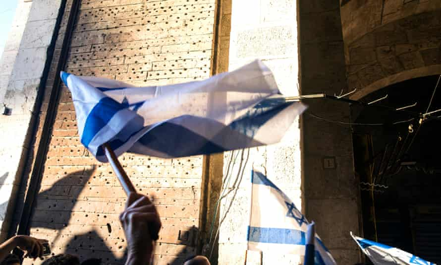 Israeli flags at the Damascus Gate into the Muslim Quarter of Jerusalem's Old City on the 50th anniversary of its capture by Israeli paratroopers in 1967
