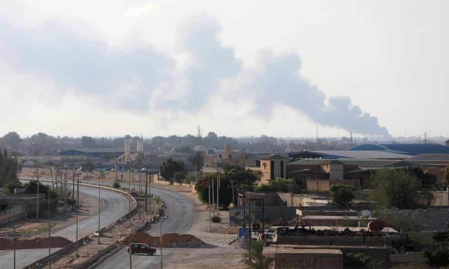 Smoke rises during clashes