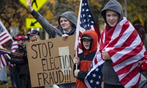 Trump supporters in Salem, Oregon, hold signs as they attend a 'stop the steal' rally against the outcome of the presidential election, in November.