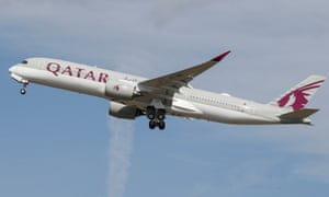 A Qatar Airways aircraft takes off.