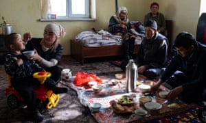 Abdilla and his family have lunch at home in Sary-Mogol.