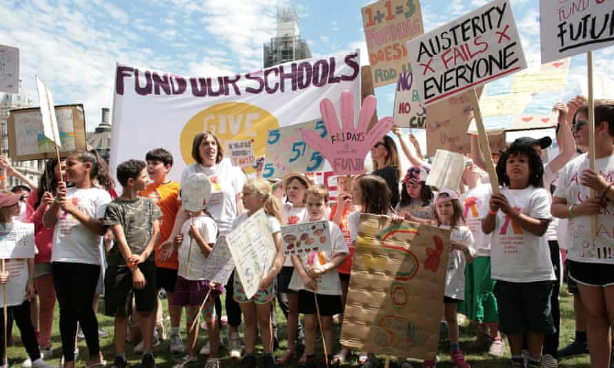 Parents and children protesting outside parliament last week against funding cuts that are forcing schools to close early on Fridays.