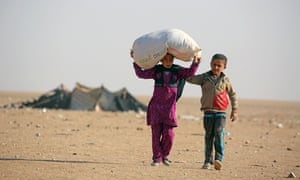 Child refugees from the northern Iraqi city of Mosul make their way to the Al-Hol camp, close to the Iraqi border in northeastern Syria.