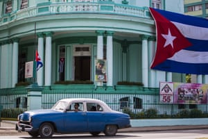 A Cuban flag and a picture of Fidel Castro decorates the headquarters of the Committees for the Defence of the Revolution