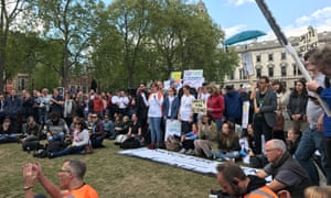 Crowds gather at Parliament Square to listen to speakers from the worlds of science, journalism and comedy.