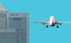 Airplane heads toward the Canary Wharf buildings