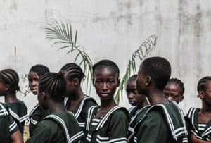Yagazie Emezi: A child's direct stare during the parade for International Day of the Girl Child in Monrovia, Liberia