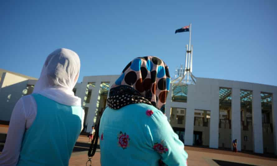 Women wear hijabs outside Parliament House in Canberra