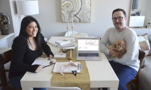 Karina L. Lopez, left, poses with her fiance Curtis Rogers and their dog Fifi at their home in the Long Island, New York, on Saturday, 4 April 2020. The pair have long been planning their summer wedding celebration. Both tested positive for the coronavirus, but said they were continuing to plan and send out invitations to their wedding, whether it ended up being a huge party or a marriage by Zoom in their living room.