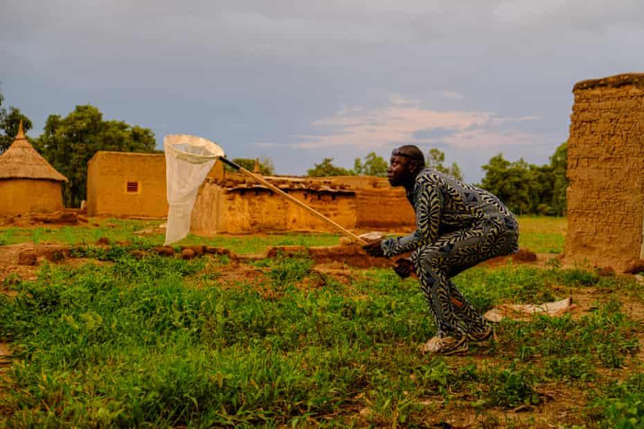 A mosquito catcher at work in Bana, Burkina Faso