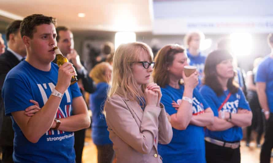 Supporters of the 'Stronger In' campaign watch the results of the EU referendum being announced on the morning of 24 June 2016.