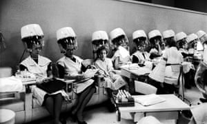 Women sitting under hairdryers