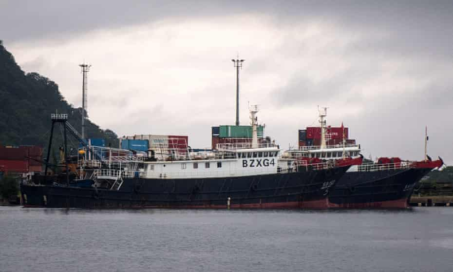 A pair of Chinese fishing vessels are berthed at an unused wharf in Port Vila as Vanuatu authorities consider their next steps. The crew will be quarantined before they can be released.