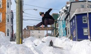 A snowboarder in St John's