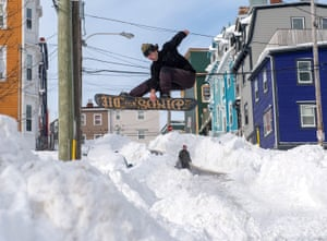 St. John's, Canada. A snowboarder takes advantage of prime conditions. The state of emergency ordered by the City of St. John's continues, leaving businesses closed and vehicles off the roads in the aftermath of the major winter storm that hit the Newfoundland and Labrador capital