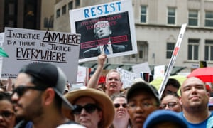 Thousands gather at Daley Plaza in protest against the immigration policies of Donald Trump, in Chicago.