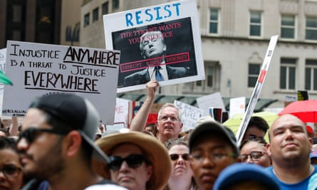 People protest Donald Trump's immigration policies in Chicago.