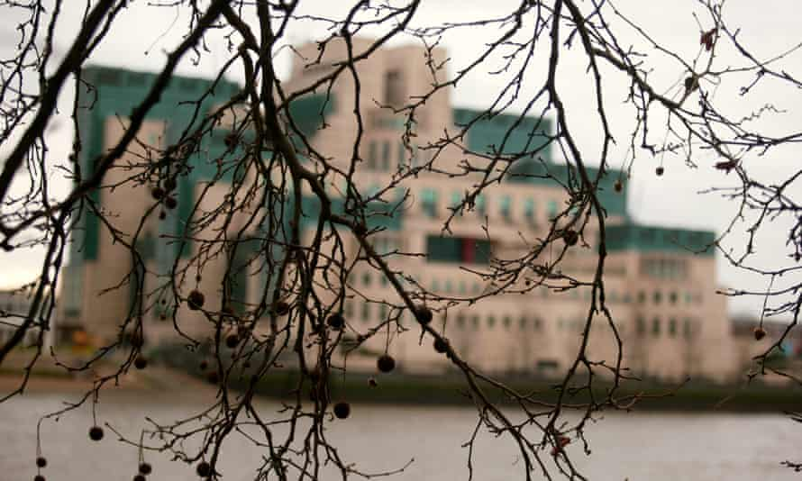 The MI6 building in Vauxhall, obscured by trees. The secrecy around the agency's work poses a problem for recruitment.