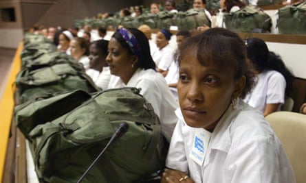 Hundreds of doctors with backpacks loaded with medications meet in in the Karl Marx theatre in September 2005, in Havana, Cuba.