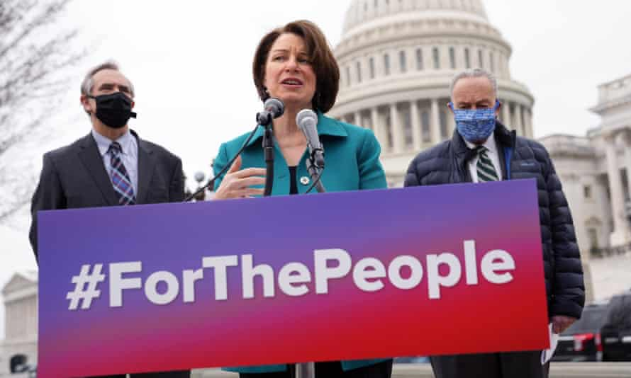 Senator Amy Klobuchar speaks on the For the People Act, with Jeff Merkley and Chuck Schumer.