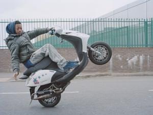 L.B. Looney wheelies along an industrial estate road, N.E. London
