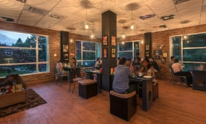 Customers sit at tables in Dylan's Café in Shillong, India. The cafe is Bob Dylan-themed.