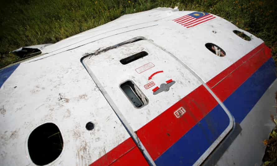 A piece of the wreckage at a crash site of Malaysia Airlines flight MH17 near the village of Petropavlivka in Donetsk region.