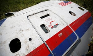 A piece of the wreckage is seen at a crash site of a Malaysian Airlines plane in Ukraine.