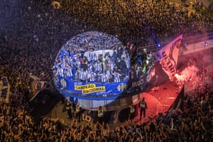 FC Porto players and coaching staff celebrate winning the Portuguese football league