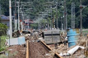Debris strewn across a railway line in Mihara