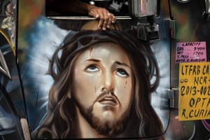 A painting of Jesus Christ on the door of a jeepney.