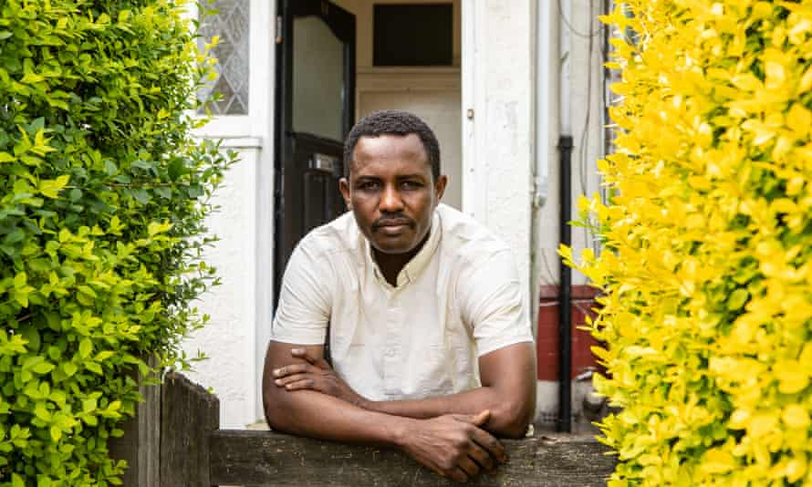 Mohammed Jouda, who has recovered from coronavirus outside his shared flat in north London.