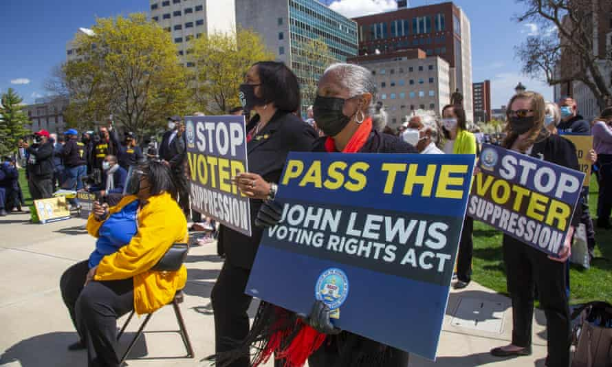 Members of the NAACP and other organizations protest Republican election law proposals in Lansing, Michigan, on 13 April.