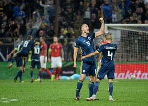 Bosnia-Herzegovina's defender Toni Sunjic reacts with joy.